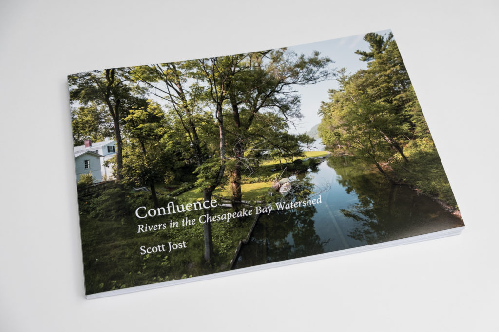 Photograph of a book of sample images from Confluences: Rivers in the Chesapeake Bay Watershed